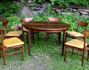 Stunning c1960 Mid-Century Modern Rosengren Hansen Solid Rosewood Round Dining Table w 2 Leaves and 6 Chairs