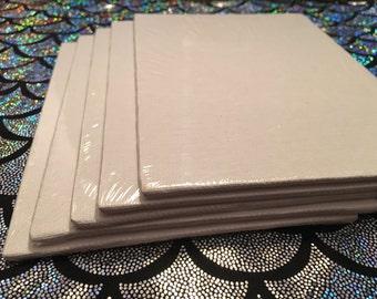 Five (7x5) white canvas