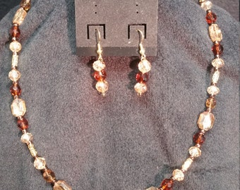 Amber/goldtone/crystal necklace and earrings   22inches long