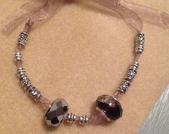 Purple ribbon bracelet