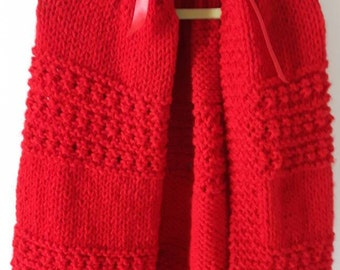 Red knitted girl's cape