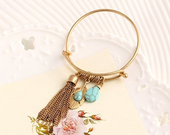 Bohemian bangle bracelet with turquoise and feather charms