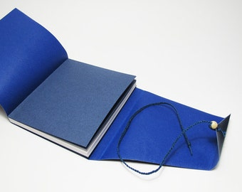 Journal with a flap and a clasp braided leather