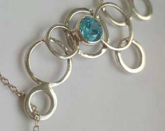 Beautiful unique silver circles pendant with blue zirconia