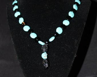 Turquoise and black skull necklace