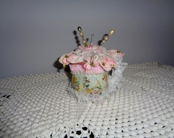 Porcelain cup pincushion