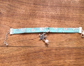 Bracelet turquoise Liberty with flowers white and charms