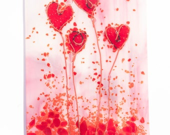Fused glass pink and red heart shaped flowers