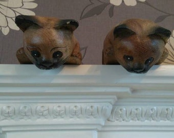Pair of hand carved shelf cat's.