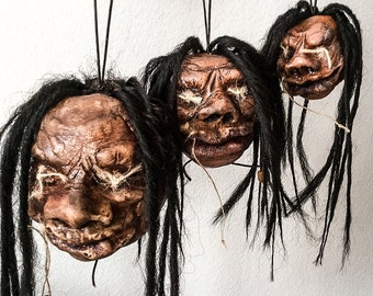 Shrunken head (tzantza)  from Harry Potter and the Prisoner of Azkaban. Trinket Jamaican shrunken heads/ritual, or trade purposes.