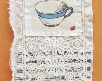 Small art quilt, antique lace, ticking, tea cup, tea time, handstitch and embroidery