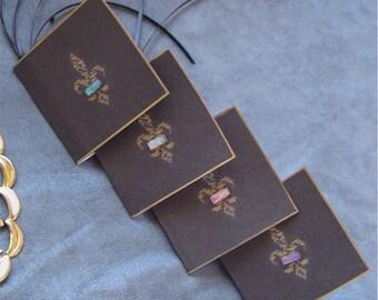 Gift card tags fleur de lis on black gold trim gems