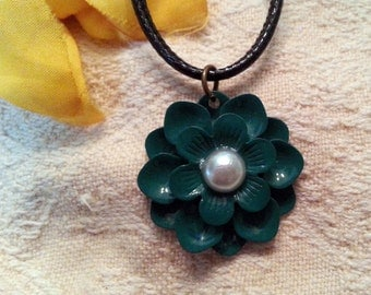 Turquoise green flower with pearly center pendant on a black cord necklace