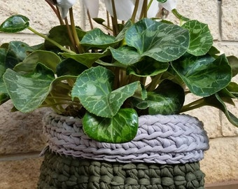 Green hand crocheted  basket with a grey trim. Plant is not included.