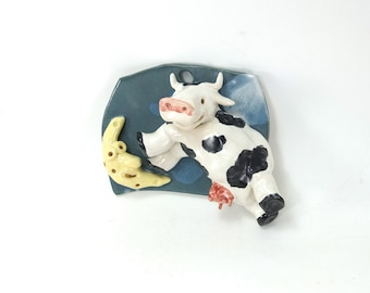 cow over the moon sculpted wall piece