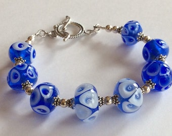 Lampwork Bracelet  Blue White Sterling Silver Dots Glass Unique Glass beads melted in my shop