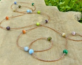 Colorful long seed bead and fiber optic cats eye necklace. Blue, green, orange, purple, olive green, light brown. Entwine Art
