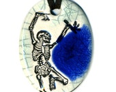 Dancing Skeleton Necklace in Crackle and Blue Glass