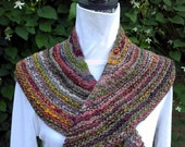 A little shawlette/scarf to keep your shoulders warm. Knit from multicolored striped handspun wool yarn, OOAK