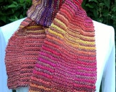 Handspun handknit scarf in alternating stripes that constantly change. Knitted in my own design, this is a OOAK piece