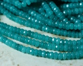 Candy jade faceted rondelle deep sea blue 4mm 15-inch strand (item ID CJRN4mSB)