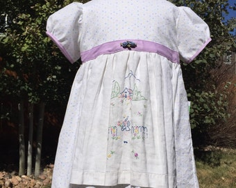 Pastel polka dot with purple trim apron dress