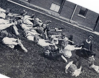 Vintage photo 1924 Children Danish School Grab Their Ankles Exercise Class