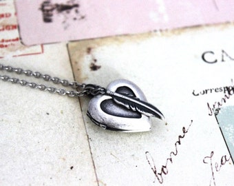 feather. heart locket necklace. in silver ox jewelry