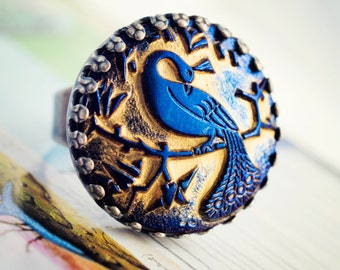 peacock ring in metallic blue and gold glass