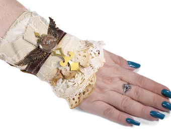 Steampunk BRiDAL Cuff LeATHER Lace Cuff LaRGE Wings Clock Key Spinning Watch Warrior Button Wedding Cuff - Steampunk Clothing by edmdesigns