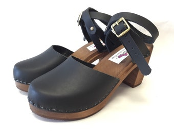 Black oiled Dalanna on a brown dyed super high heel w/ wrap around ankle strap
