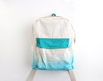 Aqua dyed backpack with turquoise pouch