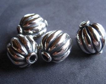 Solid Sterling Silver focal beads - 14mm X 11mm - melon carved