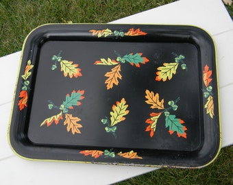 Metal vintage tray with fall leaves on black background