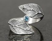 Sterling silver leaf ring with  a faceted blue topaz - elf pixie tribal boho
