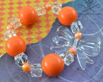 BOOTIFUL - BRIGHT ORANGE Clear Bow Iridescent Bead Stretch Bracelet