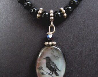 original scrimshaw crow mother of pearl and onyx bead pendant