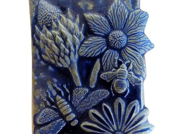 Ceramic Botanical Tile in Night Sky Blue Glaze measures 6.5 inches wide by 16 inches tall