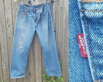 """Vintage Levi's Jeans  //  Vtg 90s Made in the USA Levi 501xx Distressed Faded Button Fly High Waist Jeans // 32"""" waist"""