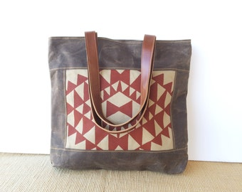 bucket tote • waxed canvas bag • brown waxed canvas - handprinted red - geometric patten - brown leather • vukani