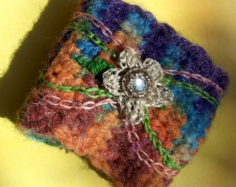 Crocheted wrist cuff multi colored bracelet or warmer with embroidery flower and button