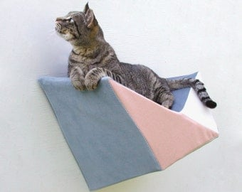 Cat shelf wall bed in peach, blue grey & ivory