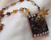 Preserved bee hive in handmade bezel necklace