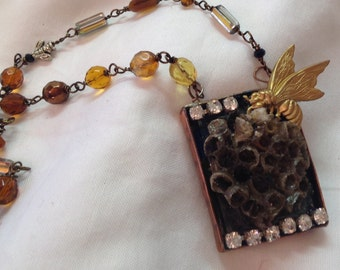 Preserved bee hive in handmade bezel necklace