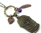 Antiqued Brass and Copper Bird Cage Bohemian Charm Necklace with Mini Heart Locket, Feather, and Purple Faux Pearl - CUTE