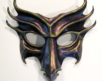 Dragon leather mask, hand-shaped and hand-painted in black, iridescent purple, and metallic green-gold,