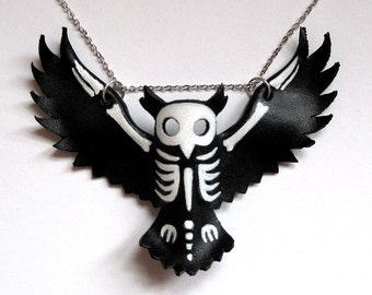 Leather owl skeleton silhouette pendant statement necklace, hand painted in acrylic with a white gold-plated chain, by Eden Bachelder
