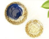 Pair of two.One large and one small resin salt and pepper spice pinch trinket dish bowls in indigo blue and gold glitter.
