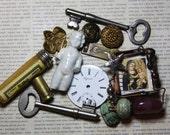 Mixed Media Lot- Frozen Charlotte Doll- Soldered Brooch- Skeleton Keys- Buttons- Porcelain Watch Face