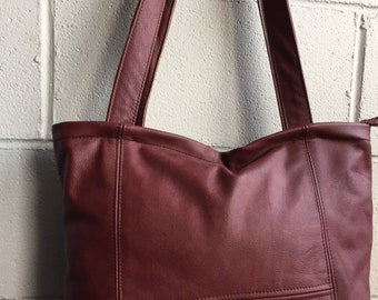 Gorgeous  cow hide leather handbag in a red color